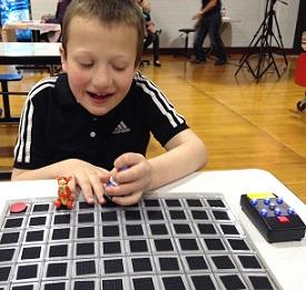 Eddie playing board game smiling