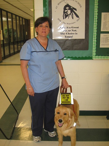 audrey in nursing uniform with her dog guide