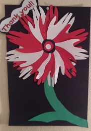 Paper flower made of red and white hand cut-outs