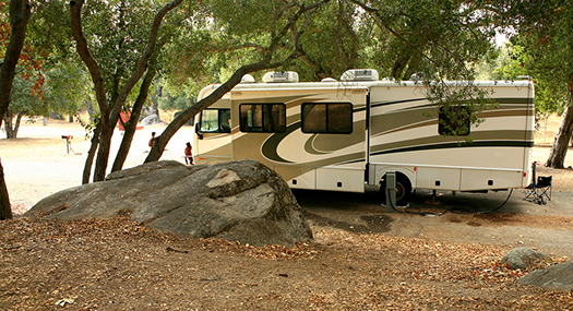 RV camper parked in a shady site