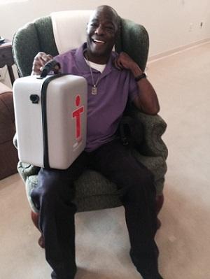 man holding emergency bag on lap