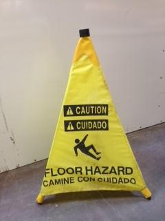 yellow sign warning of floor hazard