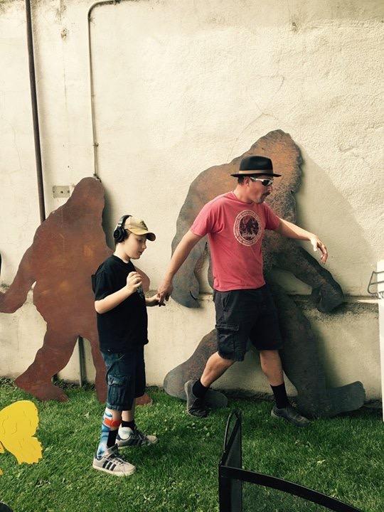 Eddie and his dad pretending to be Bigfoot