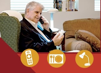 man looking at med bottle, talking on phone, using a task lamp