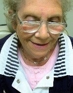 woman wearing magnifying reading glasses