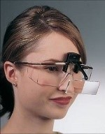 woman wearing a loupe for reading