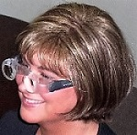 woman wearing spectacle-mounted telescopes