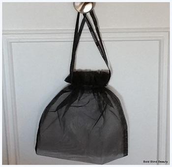 mesh bag hanging on door knob Attributed to 'BoldBlind Beauty'