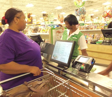 woman in check out line of grocery store