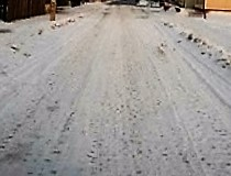 Snow creates low contrast on this road
