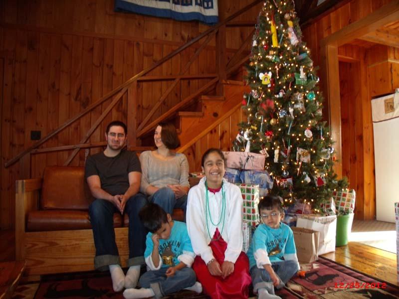 Susan Harper's children sitting by Christmas Tree