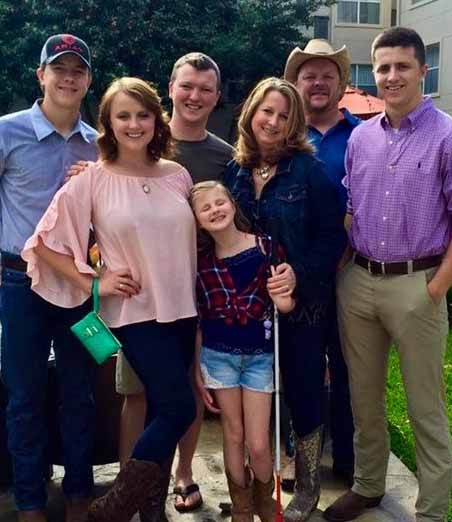 Bushland family group photo with mom, dad, 3 sons and     two daughters