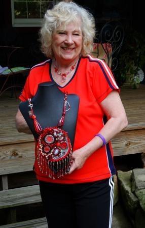 Lynda Lambert holding bleeding heart talisman