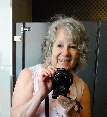 lynda lambert holding camera