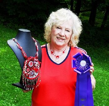 Lynda holding my bleeding heart talisman and blue ribbon