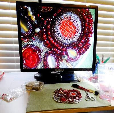 video magnifier showing bead talisman necklace magnified on screen