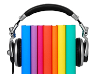 A neatly-stacked group of books set between a pair of headphones.