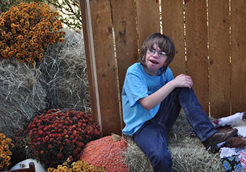 JD at age 11 sitting on a haybail