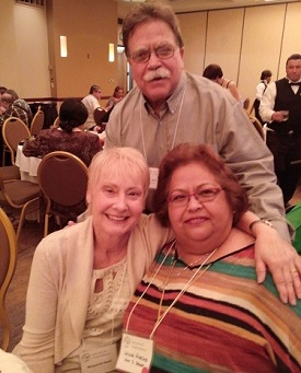Mike Bates with Barbara Dennison on left and Wilma Hinnojas on right
