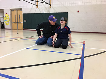 Eddie and his father playing goalball