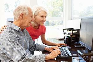 Senior man and daughter using a computer
