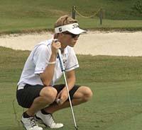 Jake lining up a put while golfing