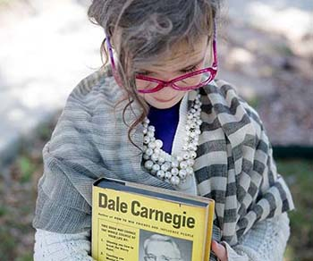 A little girl dressed up to celebrate the 100th day of school