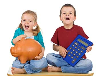 A girl and a boy sitting on the ground; the girl is holding a piggy bank, and the boy is holding a large calculator
