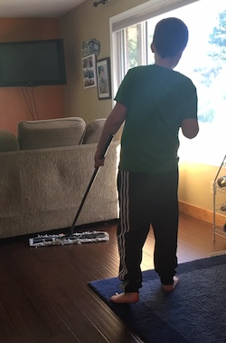 Eddie sweeping the living room floor