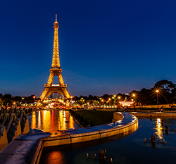 Eiffel Tower lit up at night with over 2,000 light bulbs in Paris, France