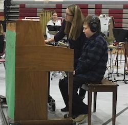 Eddie playing the piano at his sixth-grade holiday band concert