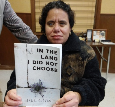 ana cuevas holding her book