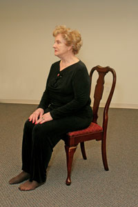 an older woman sitting on a chair