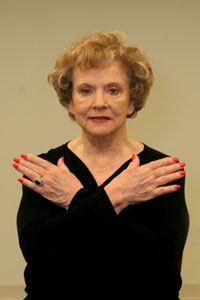 woman holding her arms in an x across her chest