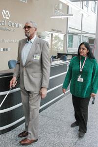 BVA member Maurice Toler receives instruction from O&M Instructor Vijaya Dabir at Washington, DC VA Medical Center.
