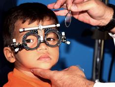 child at an eye exam