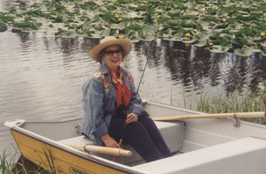 Esther Smith sitting in row boat holding fishing pole