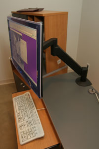 flat screen monitor mounted on an adjustable arm