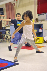 visually impaired children taking a yoga class