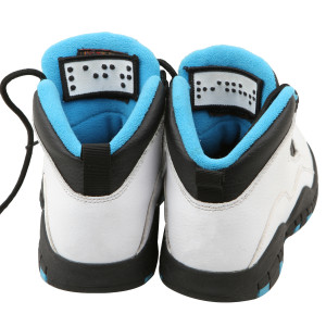 sneakers with braille tags that read Left and Right