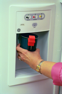 say when device being used in a cup while getting water from a refrigerator water dispenser